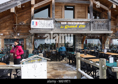 The Chalet Style Le Grand Cry Bar and Restaurant by the Slopes of the Ski Resort Les Gets in the French Alps Haute - Stock Photo