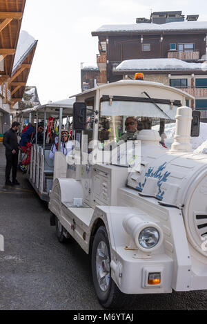 Complimentary Train for Transporting Skiers, Snowboarders and Walkers Around Les Gets Ski Resort Haute Savoie Portes - Stock Photo