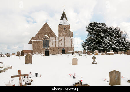 Church of St Clement, Old Romney on Romney Marsh, Kent in the snow. - Stock Photo