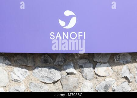 Lyon, France - March 15, 2017: Sanofi logo on a wall. Sanofi is a French multinational pharmaceutical company headquartered - Stock Photo