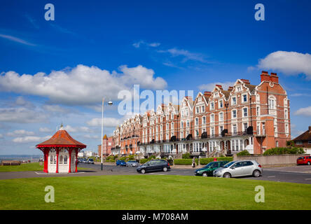 BEXHILL-ON-SEA, UK - JUN 4, 2013: Victorian wooden seafront shelter and buildings at popular seaside resort Bexhill - Stock Photo