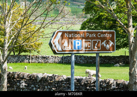 An information sign in the Yorkshire dales village of Malham North Yorkshire UK, directing visitors to the National - Stock Photo
