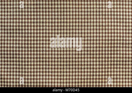 Brown textiles in a cage. Texture of cloth, close-up - Stock Photo
