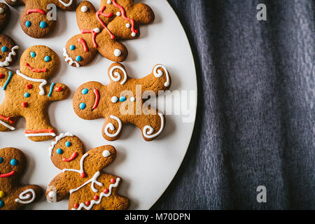 Gingerbread men on a dark background - Stock Photo