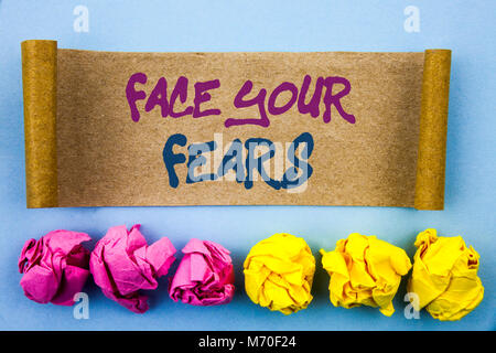 Handwriting text showing Face Your Fears. Concept meaning Challenge Fear Fourage Confidence Brave Bravery written - Stock Photo