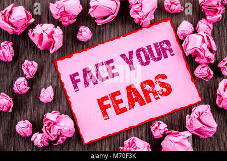 Handwriting text showing Face Your Fears. Business photo showcasing Challenge Fear Fourage Confidence Brave Bravery - Stock Photo
