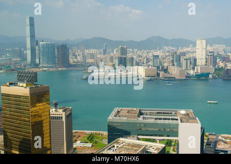 Hong Kong skyline from Victoria Peak looking over Victoria Harbour to Kowloon - Stock Photo