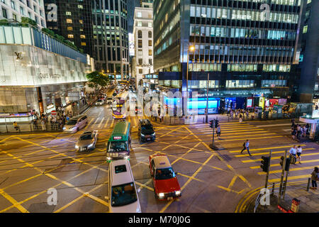 Busy street crossing in upmarket shopping area, Central, Hong Kong Island, Hong Kong - Stock Photo