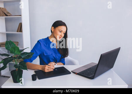 woman Graphic Designer at her working place - Stock Photo
