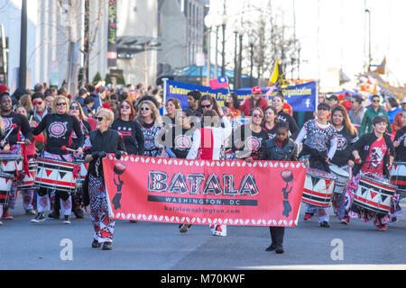 Members of Batala Washington march and play drums in the the 2018 Chinese New Year parade in Washington, DC. Batalá - Stock Photo