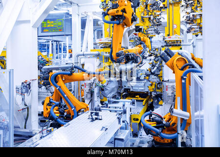 robots in a car plant - Stock Photo