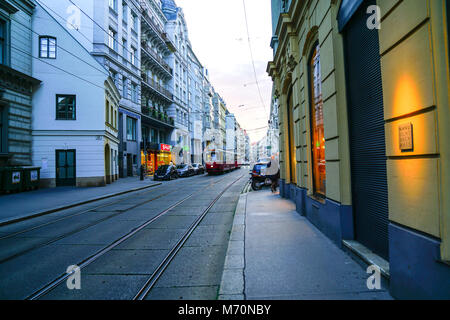 VIENNA,AUSTRIA - SEPTEMBER 5 2017;  Lights, buildings and tram tracks along inner city night streets lined on both - Stock Photo