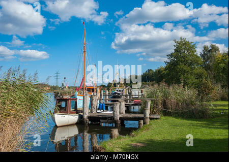 Fishing boats in natural harbor of the fishing village Gothmund at the river Trave, Gothmund, Baltic Sea, Schleswig - Stock Photo