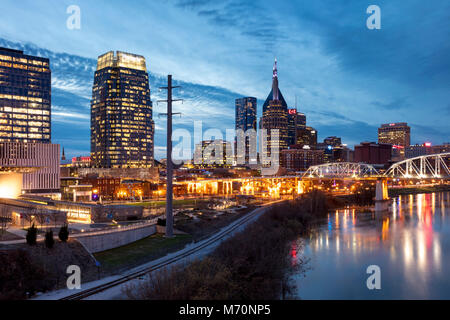 Twilight over the Cumberland River and downtown Nashville, Tennessee, USA - Stock Photo