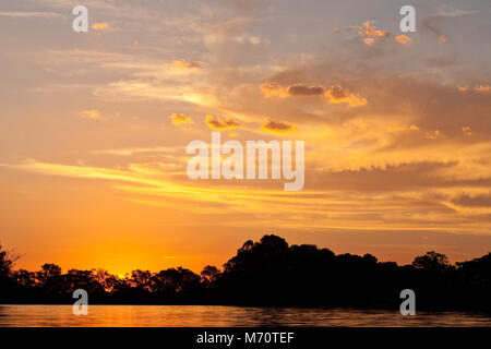 Sun sets over the Murray River, Wentworth, Australia. - Stock Photo