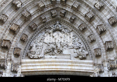 Door of Assumption on the west facade of Seville Cathedral - Stock Photo