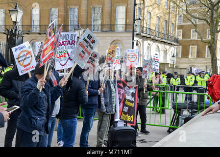 London, UK - March 7th, 2018: Protestors outside Downing Street in London, UK in opposition to Saudi Arabian Crown - Stock Photo