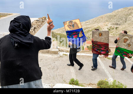Greece, Aegean Islands, Karpathos island, procession of Easter Tuesday,  a village elder throws holy water on the - Stock Photo