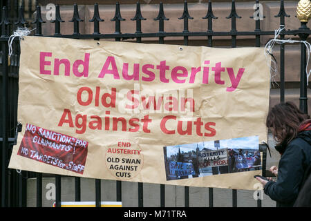 Anti austerity campaign banner banners placard placards union pension cuts demo demonstration liverpool city centre - Stock Photo