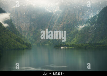 View over misty Lake Konigssee in Bavaria - Stock Photo