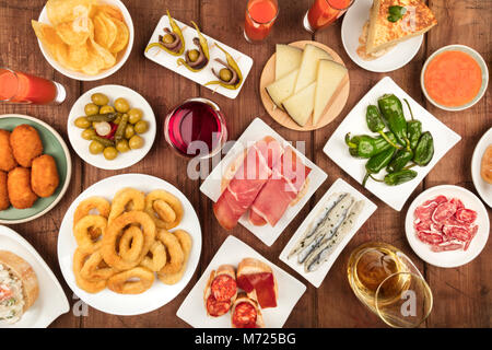 The food of Spain. Overhead photo of many different Spanish tapas - Stock Photo