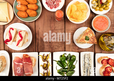 The food of Spain. Overhead photo of many different Spanish tapas with copy space - Stock Photo
