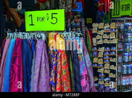 Singapore - Feb 9, 2018. Textile for sale at street market in Chinatown, Singapore. - Stock Photo