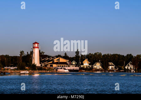 Red and White Lighthouse in Sylvan Lake, Alberta, Canada - Stock Photo