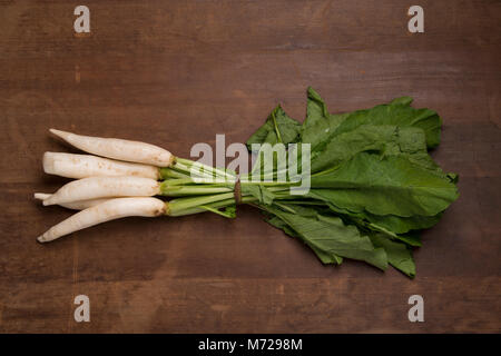 Vegetable: Top view of Bunch of Radishes on Wooden Background - Stock Photo