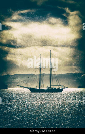 Old wooden ship in the sea under a dramatic sky.Fine art image canvas texture added. - Stock Photo