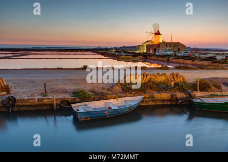 Sunset at the saltpans of Marsala in Sicily, Italy - Stock Photo