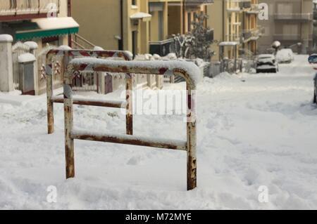 Rusted Traffic Bollards on the street (Pesaro, Italy) - Stock Photo