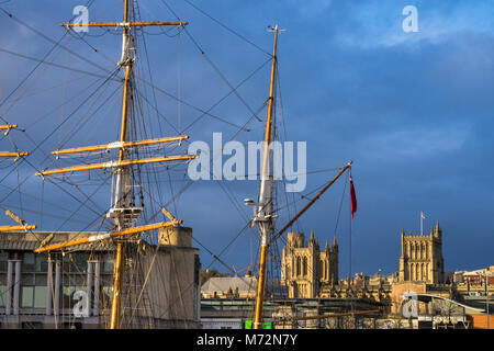Bristol Cathedral - The Cathedral Church of the Holy and Undivided Trinity -framed by the masts of the Tall Ship - Stock Photo