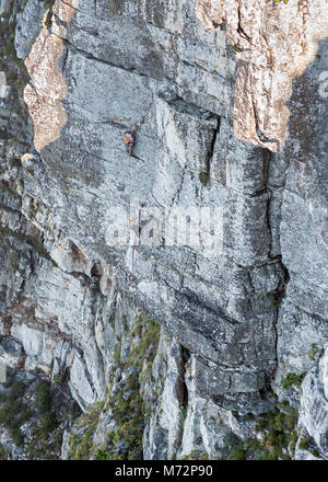 Rock climbers on the Africa Crag rock face just below the summit of Table Mountain in Cape Town. - Stock Photo