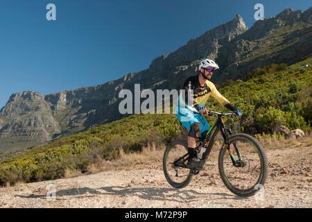 Mountain biker riding on Table Mountain in Cape Town. - Stock Photo