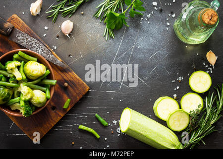 Food background. Various summer green vegetables. Preparation for baking in parchment. The concept of healthy eating. - Stock Photo