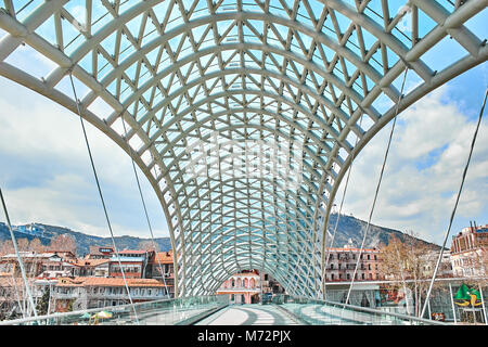 The Bridge of Peace is pedestrian bridge over the Kura River in Tbilisi, capital of Georgia. - Stock Photo