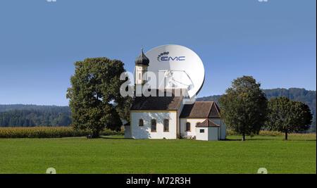 Raisting Parabolic Antenna behind Chapel - Stock Photo