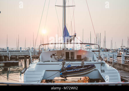 marina bay and yacht at sunset. subject is blurred and low key. - Stock Photo