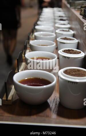 Row of Cups of tea, various kinds of tea; selective focus - Stock Photo