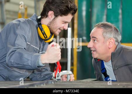 trainer encouraging the apprentice - Stock Photo