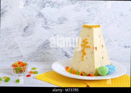 Traditional curd Easter cake with candied fruits on the holiday light background. Easter cottage cheese dessert. - Stock Photo