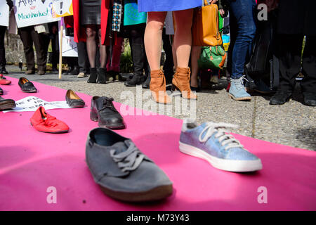 08 March 2018, Germany, Stuttgart: Women standing by a carpet, which is covered with posters. The Women's State - Stock Photo