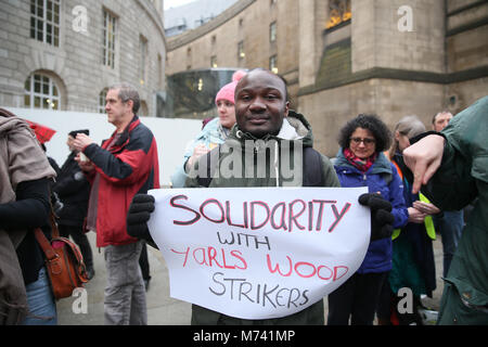 Yarlswood, Manchester. 8th Mar, 2018. A 'Solidarity with Yarlswood' poster is held up on International Women's Day - Stock Photo