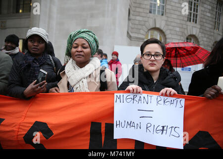 Yarlswood, Manchester. 8th Mar, 2018. A poster  which reads 'Migrant Rights Human Rights' is held up on International - Stock Photo