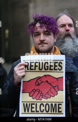 Yarlswood, Manchester. 8th Mar, 2018. 'Refugees Welcome' sign is held up on International Women's Day during a vigil - Stock Photo