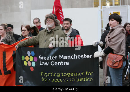Yarlswood, Manchester. 8th Mar, 2018. Greater Manchester Law Center banner is held up on International Women's Day - Stock Photo