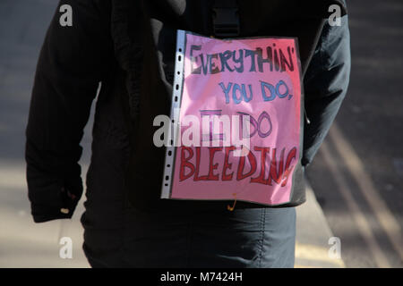 London UK 8th March 2018 Women holding plakcard during Women strike on International women's day. Credit: Thabo - Stock Photo