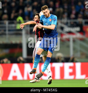 Milan, Italy. 8th Mar, 2018. AC Milan's Giacomo Bonaventura competes with Arsenal's Calun Chambers during a Europa - Stock Photo