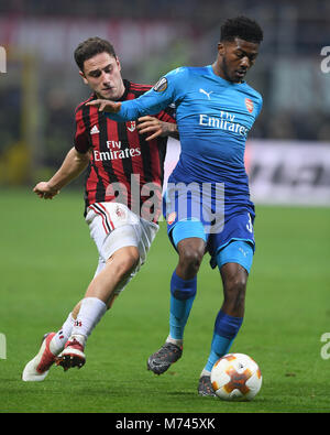 Milan, Italy. 8th Mar, 2018. AC Milan's Davide Calabria (L) competes with Arsenal's Ainsley Maitland-Niles during - Stock Photo